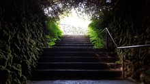 Steps Amidst Stone Wall Against Sky