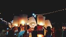 Crowd Releases Lantern In Sky