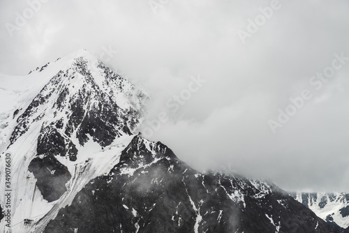 Fotografie, Obraz Atmospheric minimalist alpine landscape with massive hanging glacier on snowy mountain peak