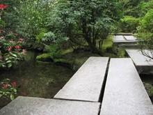 Stone Footbridge In Garden