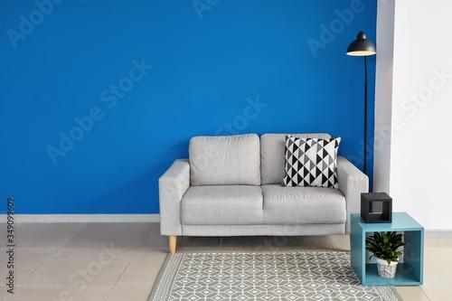Fototapeta Comfortable sofa in interior of living room obraz