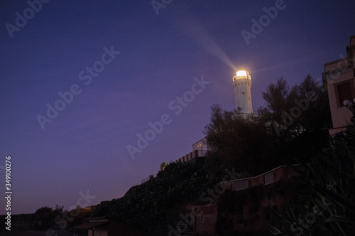 Low Angle View Of Lighthouse On Hilltop Fototapeta