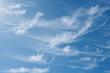 Leinwandbild Motiv Beautiful wispy cirrus clouds in blue sky on freedom, energize and joyful sunny day, clean renewable energy concept