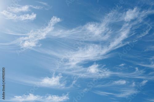 Slika na platnu Beautiful wispy cirrus clouds in blue sky on freedom, energize and joyful sunny