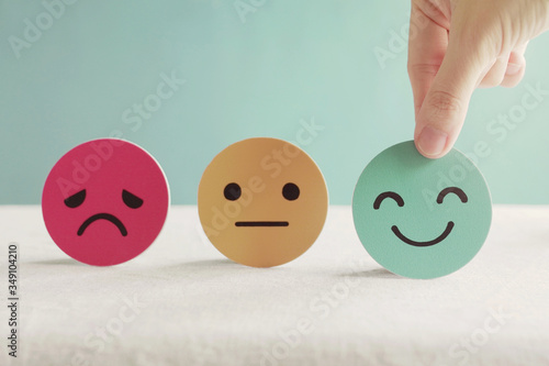 Hand choosing green happy smile face paper cut, feedback rating and positive cus Canvas Print