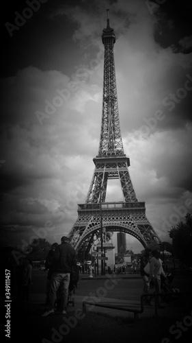 Fotografie, Obraz Eiffel Tower Against Cloudy Sky