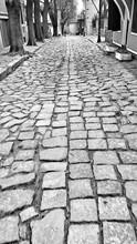 Cobblestone On Narrow Street
