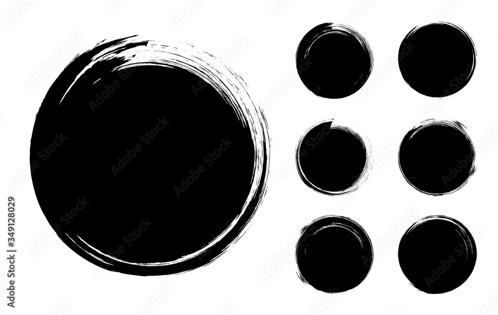 Fototapeta Collection of abstract brushed black ink circles with rough edges and grungy texture