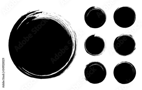 Carta da parati Collection of abstract brushed black ink circles with rough edges and grungy tex