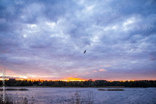 Fototapeta zachód słońca nad rzeką obraz