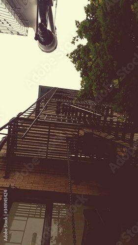 Canvas Print Low Angle View Of Fire Escape Of Building Against Sky