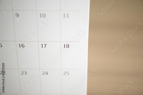 Fototapeta calendar page close up on wood table background business planning appointment meeting concept obraz na płótnie
