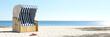 canvas print picture - Leerer Strandkorb am Strand der Ostsee oder Nordsee