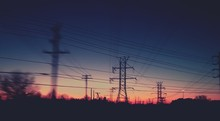 Silhouette Of Power Lines At S...