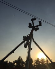 Low Angle View Of People Enjoying Amusement Park Ride During Sunset