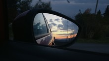 Reflection Of Sky On Side-view Mirror During Sunset