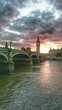 Westminster Bridge On River Thames Against Cloudy Sky At Sunset