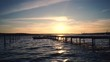 Beautiful Sunset Over Wooden Jetty and sea lake