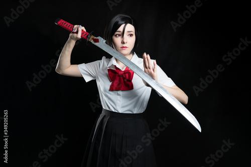 Obraz na plátně Girl with a katana in a school uniform