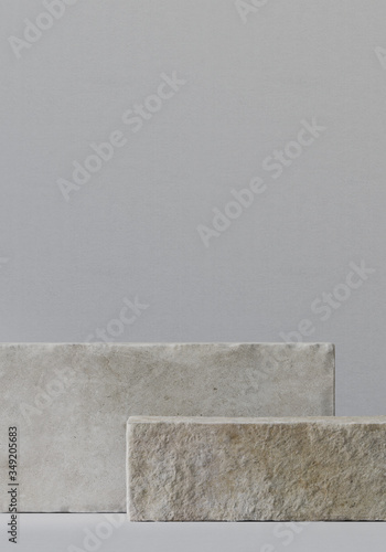 Cosmetic background for product presentation. White stone podium with grey color background. 3d rendering illustration.