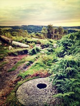 Abandoned Millstone On Field At Dusk
