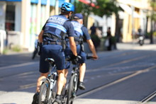 Blurry Background. Police Department Bicycle Patrol.