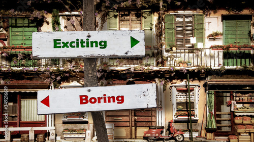 Photo Street Sign Exciting versus Boring