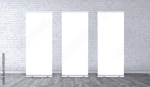 Obraz Empty three rollup banners stand. Blank template mockups. Exhibition stand 3 roll-up banners, screen for you design. Vertical white roll up for preview. - fototapety do salonu