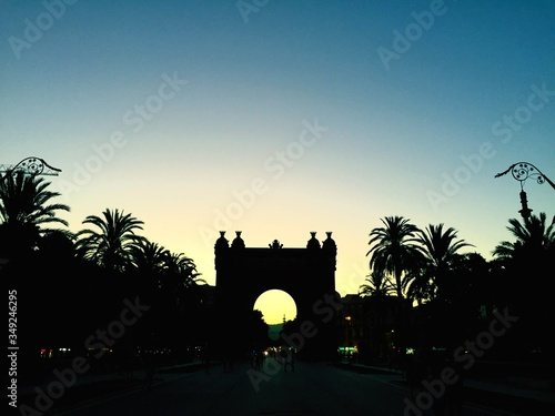 Silhouette Arc De Triomf Against Clear Sky During Sunset Wallpaper Mural