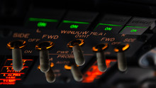 Detailed View Of The Window Heat Set Of Switches In The Overhead Panel Of A Large Airliner Cockpit . Selective Focus With Beautiful Details Of Modern Commercial Jet Aircraft Flight Deck