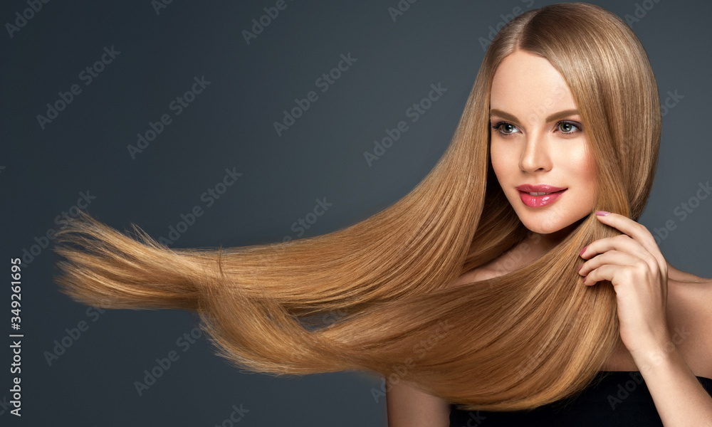 Fototapeta Beautiful model woman with shiny  and straight long hair. Keratin  straightening. Treatment, care and spa procedures. Blonde beauty  girl smooth hairstyle