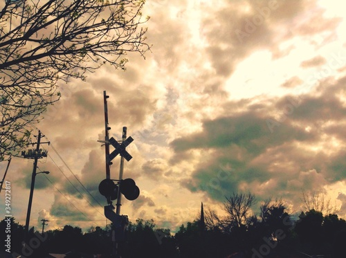 Low Angle View Of Railroad Crossing Sign Against Cloudy Sky Fototapeta
