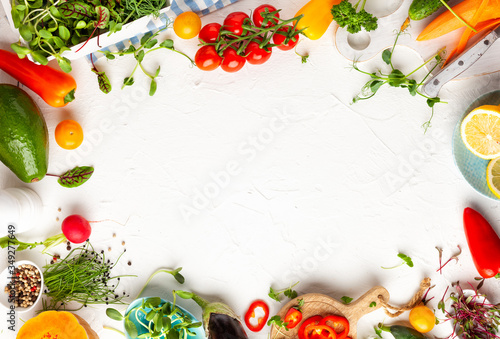 Fototapeta  Fresh vegetables, fruits, microgreens and herbs for cooking healthy meals at home. Food frame with copy space, top view. obraz