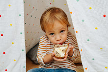 Cute Little Boy Eating Bread A...