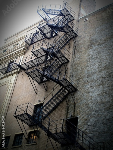 Canvas-taulu Low Angle View Of Fire Escape Of Building