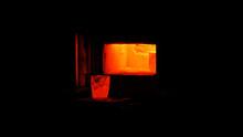 Glowing Hot Crucible By An Open Furnace Door
