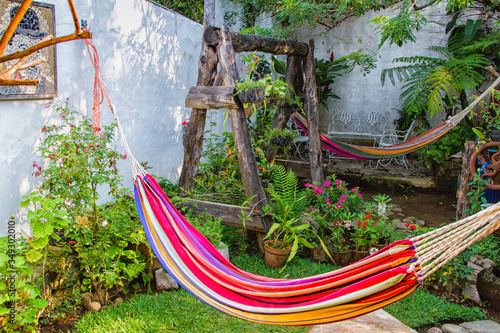 Fototapeta Hammock in the garded inside a house in El Salvador, Central America
