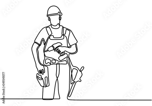 Obraz One single line drawing of young handyman wearing helmet while holding drill machine. Handsome handyman using drill machine to drilling wooden wall. Repairman construction maintenance service concept - fototapety do salonu