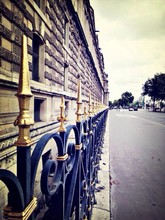 Wrought Iron Fence Along Street And Building