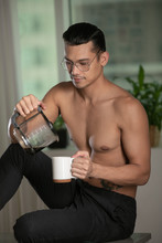 Handsome Guy Pours Coffee