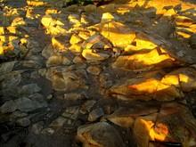 Sunlight Falling On Rocks
