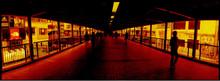 Silhouette People Walking On Bridge During Sunset
