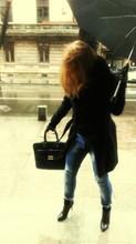 Woman With Umbrella On Sidewalk