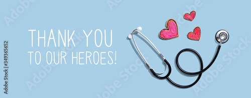 Obraz Thank You to Our Heroes message with stethoscope and hand drawing hearts - fototapety do salonu