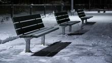 Empty Bench On Snowy Road