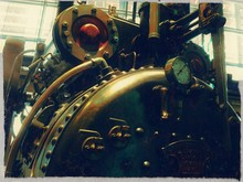 Close-up Of Steam Engine In Factory