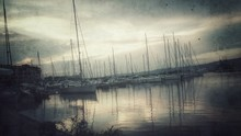 Sailboats Moored On Lake