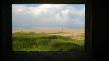 View Of Beach Seen Through Window