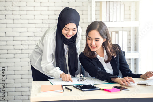 office work place with multiethnic asian female muslim workers working together Fototapet
