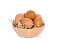 Eggs In Wooden Bowl Isolated O...